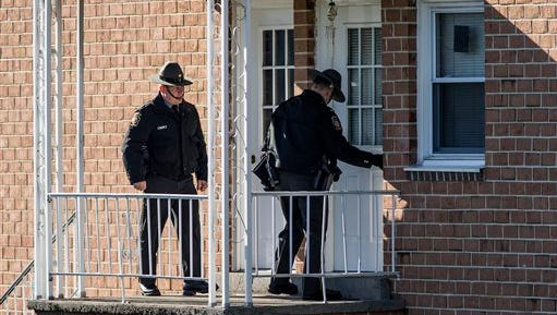 In this Monday, Jan. 11, 2016 photo, State police investigate the scene of a deadly shooting at Pfautz Rentals apartments in Penn Township, Pa. Authorities said a 12-year-old girl was shot and killed during a confrontation between her father and a state constable serving an eviction order at their central Pennsylvania apartment.