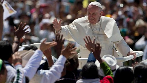 Pope Francis waves to the crowd as he leaves after celebrating Mass in San Cristobal de las Casas, Mexico, Feb. 15, 2016.