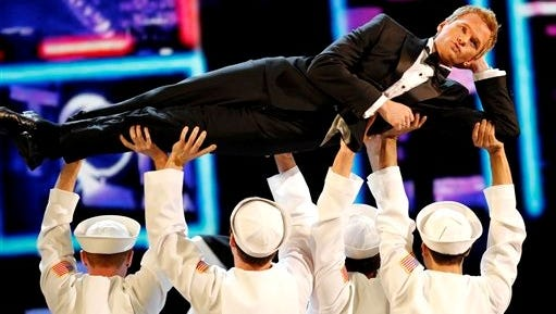 Host Neil Patrick Harris performs during the opening number of the 65th annual Tony Awards.