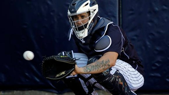 New York Yankees catcher Gary Sanchez prepares to catch the ball in the bullpen during a spring training baseball workout Friday, Feb. 19, 2016, in Tampa, Fla. (AP Photo/Chris O'Meara)