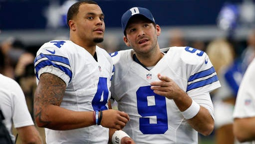 Dallas Cowboys' Dak Prescott (4) and Tony Romo (9) talk on the sideline in the first half of an NFL football game against the Baltimore Ravens on Sunday.