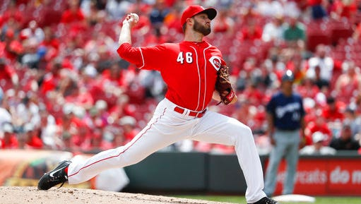 Cincinnati Reds reliever Tim Adleman throws in the fifth inning of a baseball game against the Milwaukee Brewers, Sunday, April 16, 2017, in Cincinnati. The Brewers won 4-2. (AP Photo/John Minchillo)