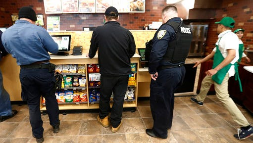 FILE - In this March 23, 2017, file photo, customers use a touchscreen to order food at a QuickChek convenience store in Cedar Knolls, N.J. In 2016, 22 percent of convenience stores' sales came from prepared foods like pizzas, sandwiches, burgers, coffee and fountain sodas, up steadily from 13 percent in 2010, according to a preliminary annual report released by an industry association.
