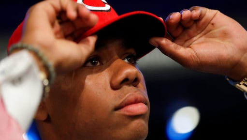 Hunter Greene, a pitcher and shortstop from Notre Dame High School in Sherman Oaks, Calif., adjusts his hat after being selected No. 2 by the Cincinnati Reds in the first round of the Major League Baseball draft, Monday, June 12, 2017, in Secaucus, N.J.(AP Photo/Julio Cortez)