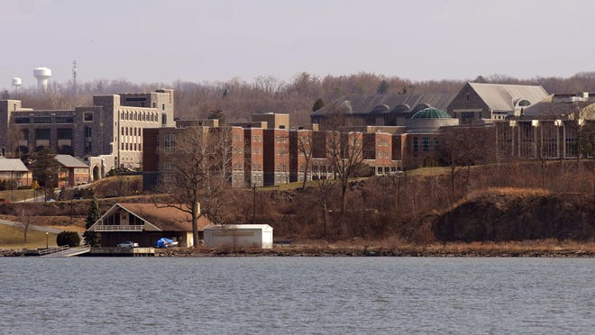 A view of the Marist College campus as seen from west side of the Hudson River in Highland. Photographed on Thursday, March 15, 2012. The view includes from left, Hancock Center, Midrise Hall, James A. Cannavino Library and the Student Center/Rotunda.