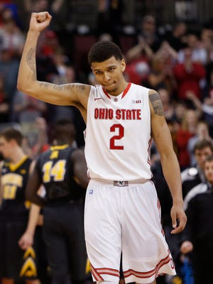 Ohio State's Marc Loving celebrates his team's win over Iowa in Columbus, Ohio.