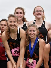 The Palmyra girls 4x800 relay team stands on the podium