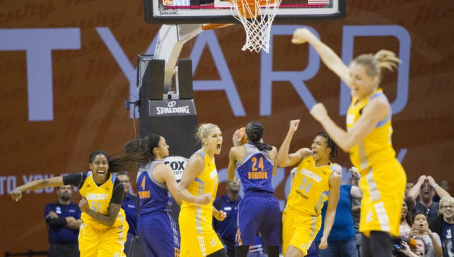 Sky forward Jessica Breland (51), forward/guard Elena Delle Donne (11) and center Imani Boyette (34) celebrate after hitting a buzzer-beater to defeat the Mercury 77-75 on Tuesday, July 19, 2016, at Talking Stick Resort Arena in Phoenix.