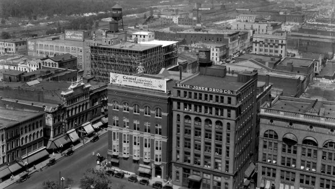 A view of Downtown Memphis showis the Northwest corner of Court Square at lower left with Oak Hall visible on Main Street at North Court in this undated photograph by Bluff City Engraving Company. The Poplar Street Station, from which Casey Jones started his famous final run, is situated to the right of the water tower located in upper left center of the photograph.