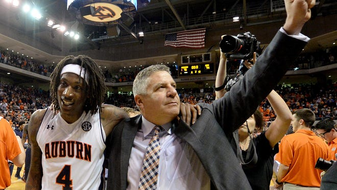 Auburn guard T.J. Dunans and coach Bruce Pearl celebrate a 75-74 win over UAB in the 2015-16 season opener.