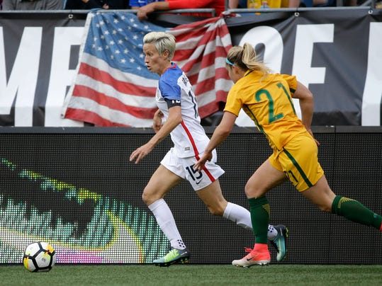 United States midfielder Megan Rapinoe (15) moves the ball away from Australia defender Ellie Carpenter (21) in the first half of a Tournament of Nations women's soccer match, Thursday, July 27, 2017, in Seattle. (AP Photo/Ted S. Warren)