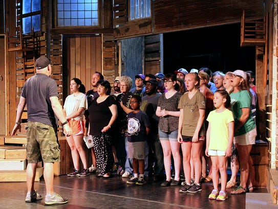 Director Barry Smoot instructs his cast, which includes