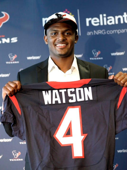 Quarterback Deshaun Watson holds up his Houston Texans jersey after a news conference Friday, April 28, 2017, in Houston. The Texans drafted Watson in the first round of the 2017 NFL Draft. (AP Photo/David J. Phillip)