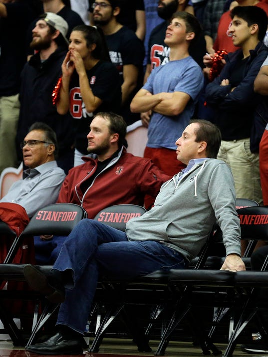 Golden State Warriors co-owner Joe Lacob, seated at right, watches during the second half of an NCAA college basketball game between Saint Mary's and Stanford on Wednesday, Nov. 30, 2016, in Stanford, Calif. (AP Photo/Ben Margot)