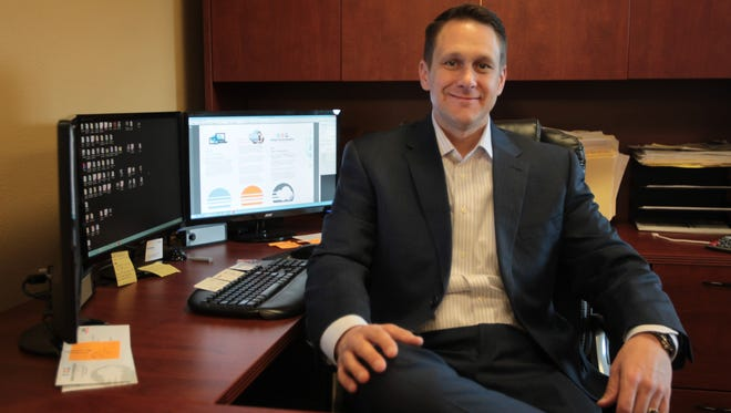 Brett Helgeson, Principal of Adopt Technologies, is pictured at his headquarters in Phoenix.