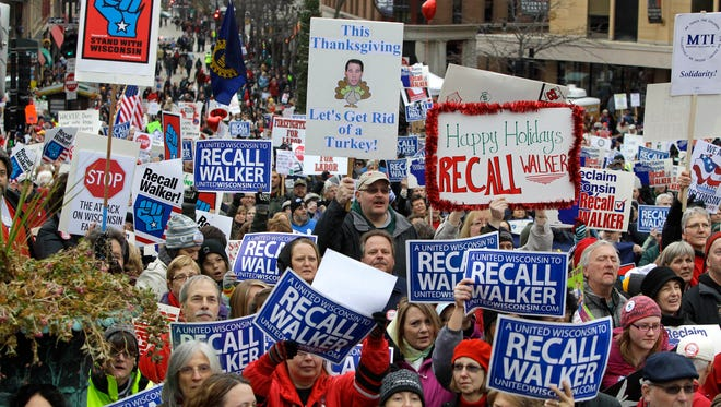 "Colorful signs, recall petitions and blunt messages were displayed as more than 10,000 people gathered at the State Capitol in Madison for the ""We Are Wisconsin"" rally and petition signing for the recall of Governor Scott Walker on Nov. 19, 2011."