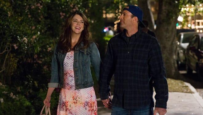 Lorelai (Lauren Graham), left, and Luke (Scott Patterson) take a walk through Stars Hollow in Netflix's 'Gilmore Girls: A Year in the Life.'