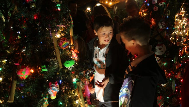 Colorful holiday lights are a tradition at the Edison & Ford Holiday Nights celebration, one of the many family-friendly events this Thanksgiving weekend.