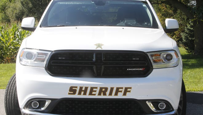 Two people died late Saturday in a one-car, roll-over crash near Montmorenci.