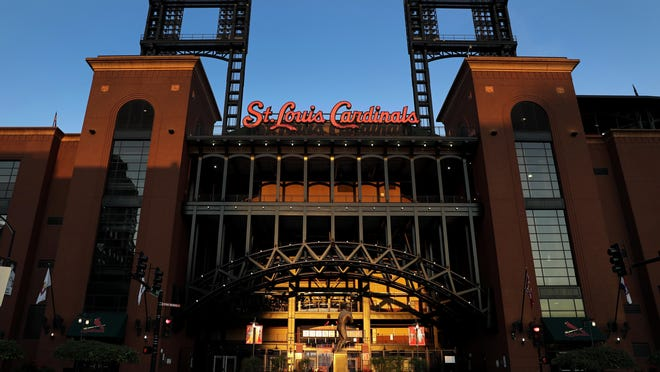Busch Stadium, home of the St. Louis Cardinals, remains quiet Friday, Aug. 7, 2020, in St. Louis. Major League Baseball announced Friday night that the entire three-game series between the Chicago Cubs and Cardinals set for this weekend in St. Louis would be postponed after two more Cardinals players and a staff member tested positive for the coronavirus.