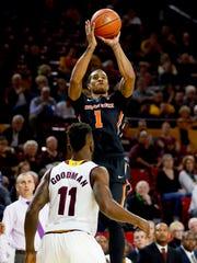 Oregon State's Gary Payton Jr. shoots over Arizona State's Savon Goodman (11) during the first half of an NCAA college basketball game, Thursday, Jan. 28, 2016, in Tempe, Ariz. (AP Photo/Matt York)