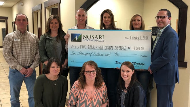 """Nosari Home Mortgage proudly presented a $10,000 donation to the Comprehensive Fundraising Campaign for the Food Bank of North Central Arkansas on Feb.1. Food insecurity is a prevalent problem in the Twin Lakes Area, and Chris and Kelley Nosari, and the staff at Nosari Home Mortgage were compelled to help. The Food Bank of North Central Arkansas' comprehensive campaign aims to raise 1.5 million dollars to renovate their facility into the warehouse and processing center that is necessary to provide for their nine county service area. Food Bank CEO, Jeff Quick, stated that The Bridging Hunger, Building Hope Campaign has raised approximately 50 percentof their goal. Chris Nosari said, """"In our line of work, we help people reach their dreams of owning a home, and to know that some people's dreams are just to provide enough food for their family is devastating. Helping the Food Bank expand their facility was a no brainer for us.""""To make a donation to the Food Bank of North Central Arkansas, contact (870) 499-7565. Participating in the donation were: (first row, from left) Mandi Riggs, Amanda Stillman, Ashley Green, (second row)Danny Ferguson, Chelsea Patterson, Chris Nosari, Kelley Nosari, Susan Stockton andJeff Quick."""