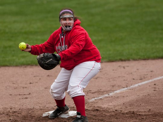 Port Huron's Dayle McKinley forces an out at third