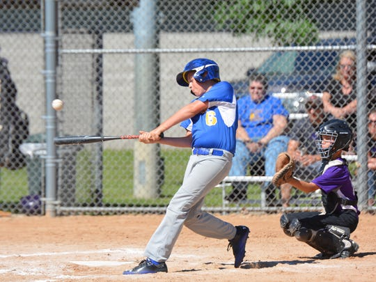 Carter Koch connects for an RBI single in the game against Gladstone in the 2018 Oconto Little League Tournament.