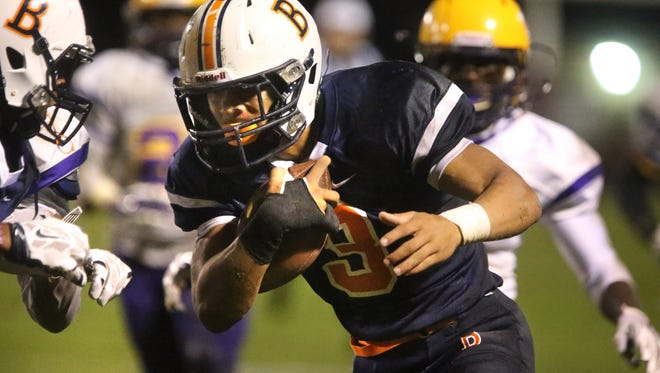 Blackman's Taeler Dowdy (3) runs the ball down the sideline into the endzone to score the first Blackman tourchdown of the night against Smyrna at Blackman, on Friday Oct 2, 2015.