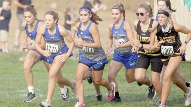 Members of the Boonville girls cross-country prepare to take off from the starting line Tuesday during the annual Boonville Cross-Country Invitational at Kemper park.
