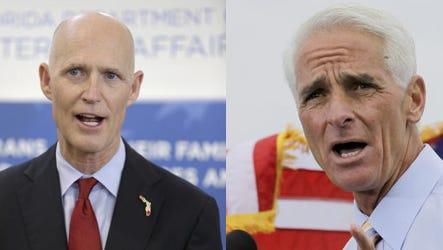Florida Gov. Rick Scott and former Gov. Charlie Crist