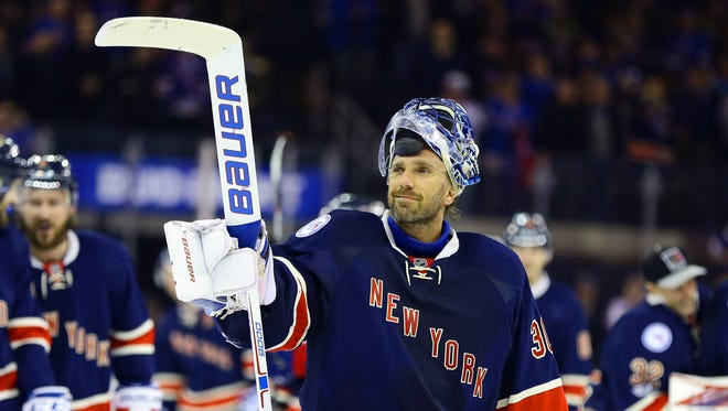 Feb 11, 2017; New York, NY, USA; New York Rangers goaltender Henrik Lundqvist (30) salutes the fans after defeating the Colorado Avalanche 4-2 at Madison Square Garden. The win was Lundqvist's 400th NHL win.