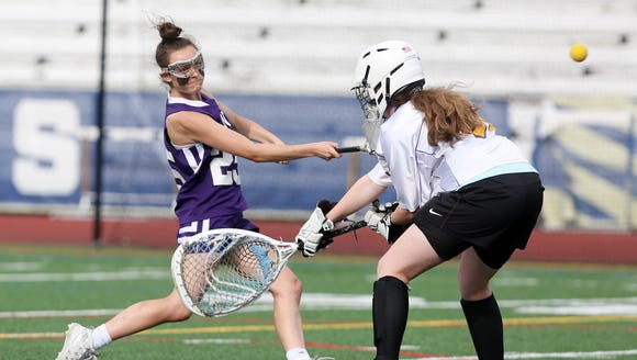 John Jay's Charlotte Wilmoth (25) fires a shot that