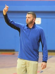 Central High School boys basketball coach Dustin Faught gives instructions during a game against Kerrville Tivy at the Doug McCutchen Memorial Tournament at Babe Didrikson Gym on Thursday, Nov. 30, 2017.