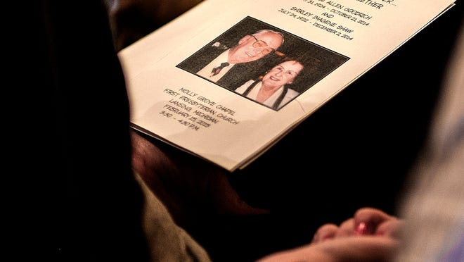People follow the program at the memorial service for Bruce and Shirley Goodrich Sunday, Feb. 15.
