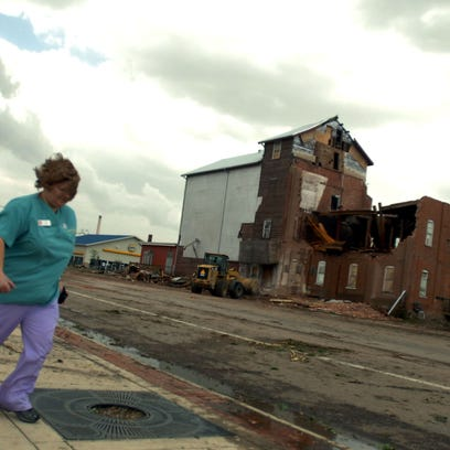 A medical worker runs down Main Street by the historic