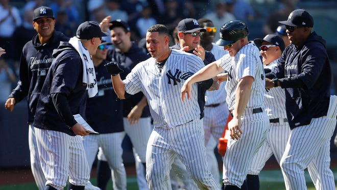 New York Yankees catcher Gary Sanchez (24) celebrates after hitting a three run home run in the ninth inning against the Minnesota Twins to win the game at Yankee Stadium.