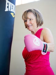"Linda Morgan punches a bag during a ""Knock Out Parkinson's"""