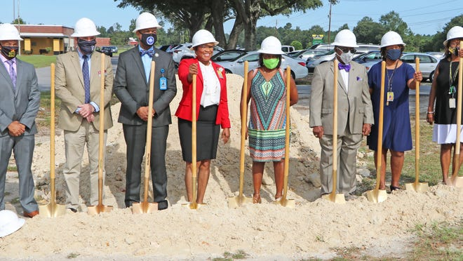 Allendale County School District officials ceremonially broke ground on a new wing addition at Allendale Elementary School on Sept. 8. Pictured left to right: Terry Hall, ACS Board of Trustees; Dr. Chris Nesmith, Dean of USC Salk; Dr. Willie Todd, president of Denmark Tech; Dr. Margaret Gilmore, ACS Superintendent; Edna Youmans, Little New Steps coordinator; Rep. Lonnie Hosey, District 91; Sheila Leath, Allendale Elementary principal; and Dr. Beverly McCullough, Fairfax Elementary principal.