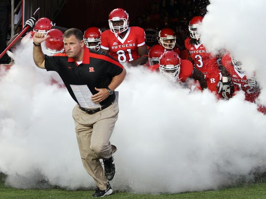 Greg Schiano leads the Rutgers football team out of the tunnel before his final home opener at the school in 2011.