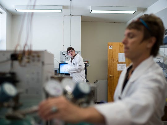 Then lab director Monica Borowicz, at right, works to analyze gases and ensure quality control with commodities on the Antares rocket in 2015. Federal authorities say an employee for a NASA contractor falsified pollution test results at NASA Wallops Flight Facility. Court documents filed April 22, 2019, identified the now ex-employee as Borowicz. The contractor wasn't named.