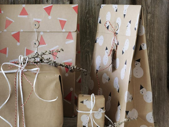 This photo provided by Ikea shows its reusable Vinter Gift Bags.