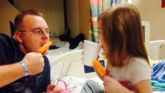 Shane Ribbing and his daughter in the St. Louis Children's Hospital.