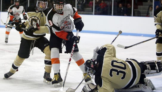 Mamaroneck's Henry Alimanistianu (3) gets his shot