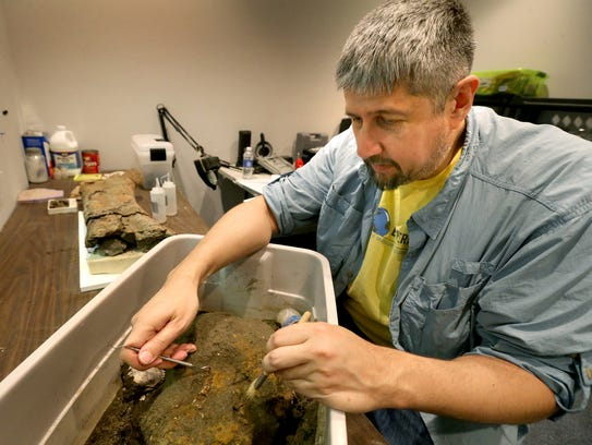 Paleontologist Alan Brown, the Executive Director of