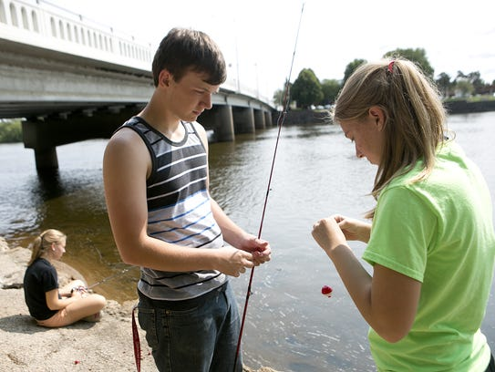 Courtney Steinkamp fishes as her sister Haley puts