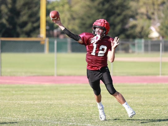Mt. Whitney QB Michael Ynclan passes down field during