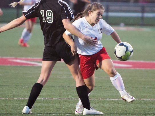 Susquehannock's Maddy Mummert, right, moves past Twin