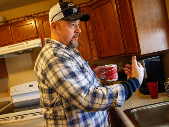 Rexnord employee John Feltner drinks a cup of coffee