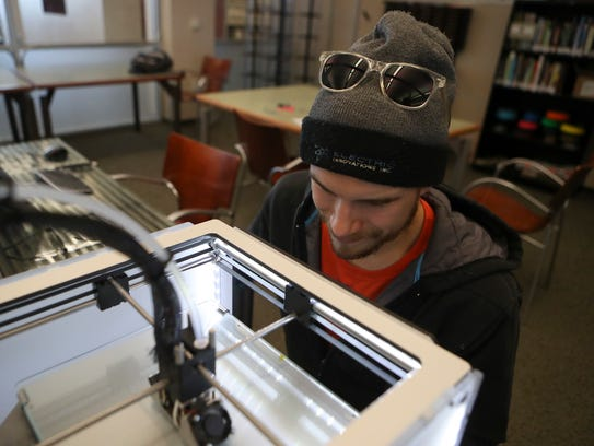 Edward Wall makes a prototype frame for glasses Thursday